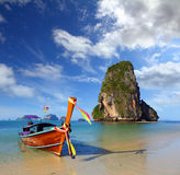Long tail boat on tropical beach (Pranang beach) and rock, Krabi Stock Images