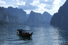 Long tail boat on tropical sea in Thailand. Asia water mountain Royalty Free Stock Photo