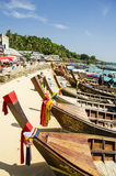 Long tail boats. Aligned long tail boats on a thai beach royalty free stock images