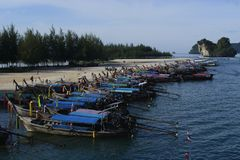 The long tail boats are anchored on the beach of Aonang in Kravy for the tourist royalty free stock photo