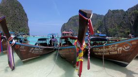 Long-tail boats on the beach of Maya Bay, Phi Phi Islands, Thailand stock video