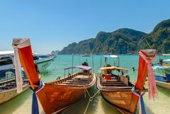 Long tail boats on the beach. In Thailand royalty free stock photography
