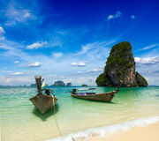 Long tail boats on beach, Thailand Stock Photo