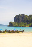 Long tail boats on a beach in Thailand Royalty Free Stock Images