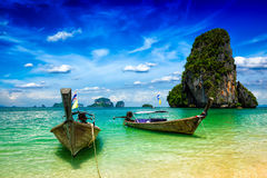 Long tail boats on beach, Thailand Stock Photography