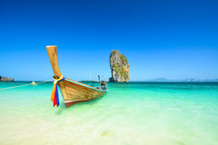 Long tail boats at the beautiful beach landscape in Thailand Royalty Free Stock Photography