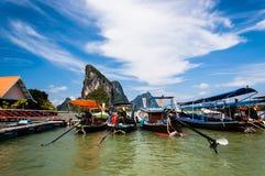 Long-tail boats & limestone karsts. Long-tail boats and limestone karsts at Koh Panyee floating fishing village, Phang Nga Bay, southern Thailand Royalty Free Stock Images