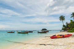 Long tail boats lined along the beach in Koh Lipe island in Thailand Stock Image