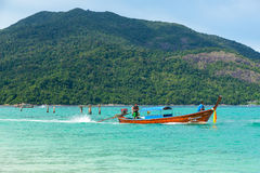 Long tail boats lined along the beach in Koh Lipe island in Thailand Royalty Free Stock Image