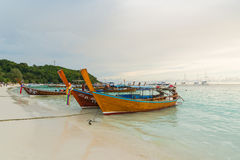 Long tail boats lined along the beach in Koh Lipe island in Thailand Stock Photos