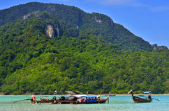 Long tail boats in Loh Dalum Bay at Phi Phi island, Thailand Stock Images