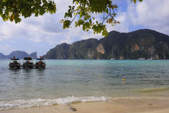 Long tail boats on paradise beach at koh phi phi island in Thailand Stock Photo