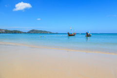Long tail boats at Patong beach, beautiful andaman sea beach at Phuket Stock Images