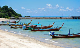 Long Tail Boats at Phuket, Thailand. A row of Long Tail Boats or Sampan at Phuket, Thailand Stock Image
