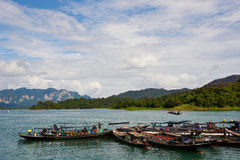 Long tail boats in Ratchaprapa Dam. Suratthani, Thailand Stock Images