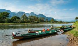 Long tail boats on Song river. Vang Vieng,Laos royalty free stock photography