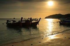 Long tail boats at sunset at Koh Lipe Royalty Free Stock Images