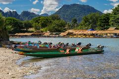 Long tail boats on sunset at Song river, Vang Vieng, Laos. Stock Photo