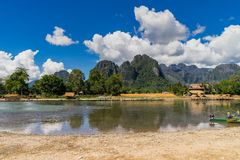 Long tail boats on sunset at Song river, Vang Vieng, Laos. Royalty Free Stock Photo