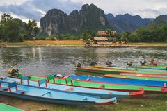 Long tail boats on sunset at Song river, Vang Vieng, Laos. Long tail boats on sunset at Song river, Vang Vieng, Laos stock photography