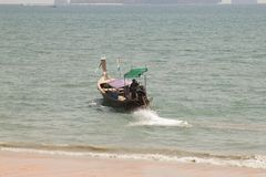 Long tail boats on tropical beach, Ao Nang, Andaman sea, Krabi,. Thailand stock photography