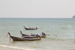 Long tail boats on tropical beach, Ao Nang, Andaman sea, Krabi,. Thailand royalty free stock photography