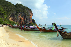 Long tail boats on tropical beach in Thailand Royalty Free Stock Photo