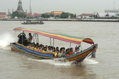 Long tail motor boat with passengers cruise on the Chao Phraya river Stock Photos