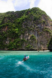 Long Tail in Sea. Long Tail Boat in crystal clear turquoise water, Ko Phi Phi Lei, Thailand Stock Photo