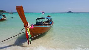 Long tail boat on turquoise colour water sea side royalty free stock photos