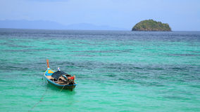 Long tail wooden boat on crystal  turquoise Andaman sea Royalty Free Stock Images