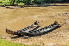 Long tail woodern motorboats in river Royalty Free Stock Photos