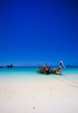 Long tailboats by the shore Stock Photo