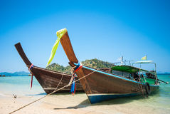 Long tailboats by the shore at Phak Bia Island, Krabi Thailand a. Gainst beautiful clear blue sky Stock Photography