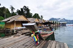 Long tailed boat with bamboo hut Stock Photos