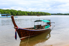 Long tailed boat floating on river Royalty Free Stock Image