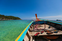 Long tailed boat. A long boat with a small motor driving a propeller at the end of a long shaft in clear ocean Royalty Free Stock Photography