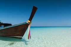 Long tailed boat on the sand beach Royalty Free Stock Image