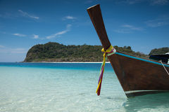 Long tailed boat on the sand beach Stock Photos