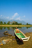 A Long-tailed Boat in Song River. At VangVieng, Lao Royalty Free Stock Photo