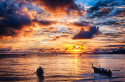 Long-tailed boat and sunset Stock Image