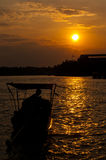 Long tailed boat at sunset Royalty Free Stock Photo