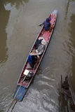 Long-tailed boat use widely spread among thai local people. Who lived near canal or river. These two villager wearing hat in summer sunny day transport in long Stock Photos