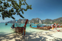 Long-tailed boats, Koh Phi Phi,Thailand. Colorfully decorated long-tail boats in turquoise water against a background of karst mountains at scenic  Koh Phi Phi Stock Image
