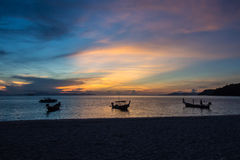 Long tailed boats shadow. Sunrise with long tailed boats shadow cast anchor Stock Images
