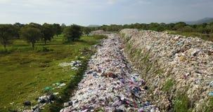 Long take bird`s eye view of garbage mountain from drone.