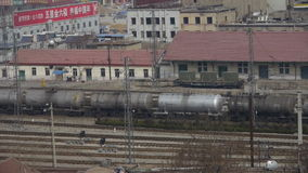 Long tank train traveling on railway in china,After railway station. stock video