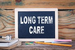 Long term care. health and safety. Chalk board Background Stock Images