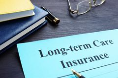 Free Long Term Care Insurance Policy On A Table. Stock Photography - 124552162