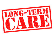 LONG-TERM CARE. Red Rubber Stamp over a white background Stock Photography